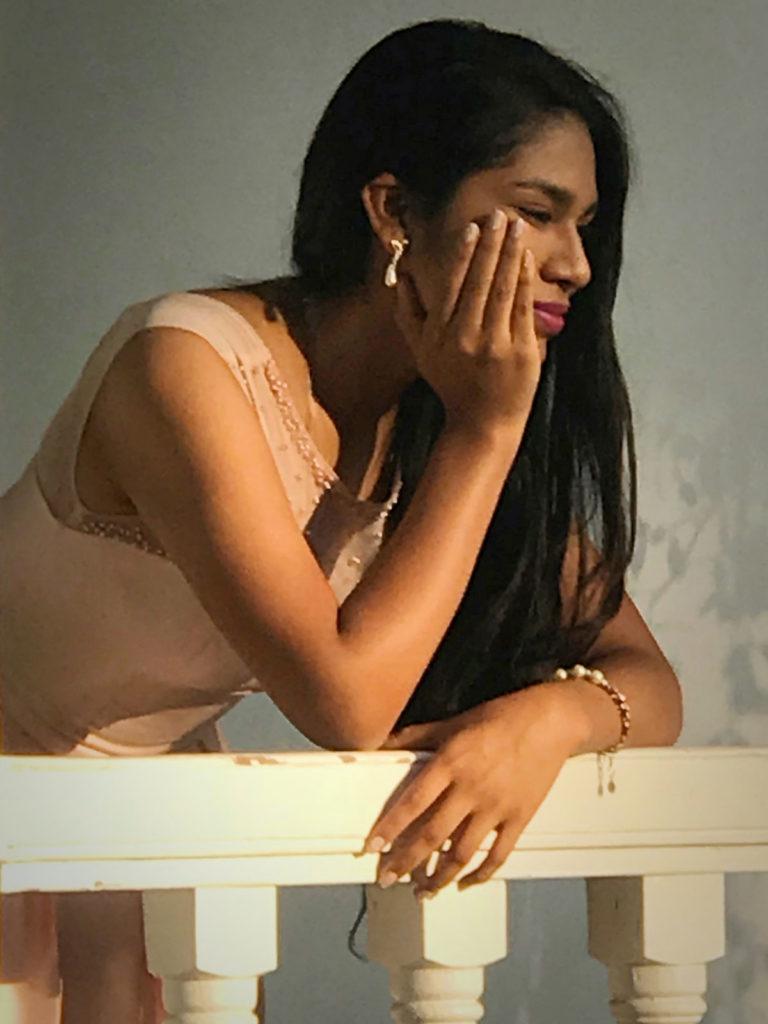 Pensive young woman on a balcony - Peru