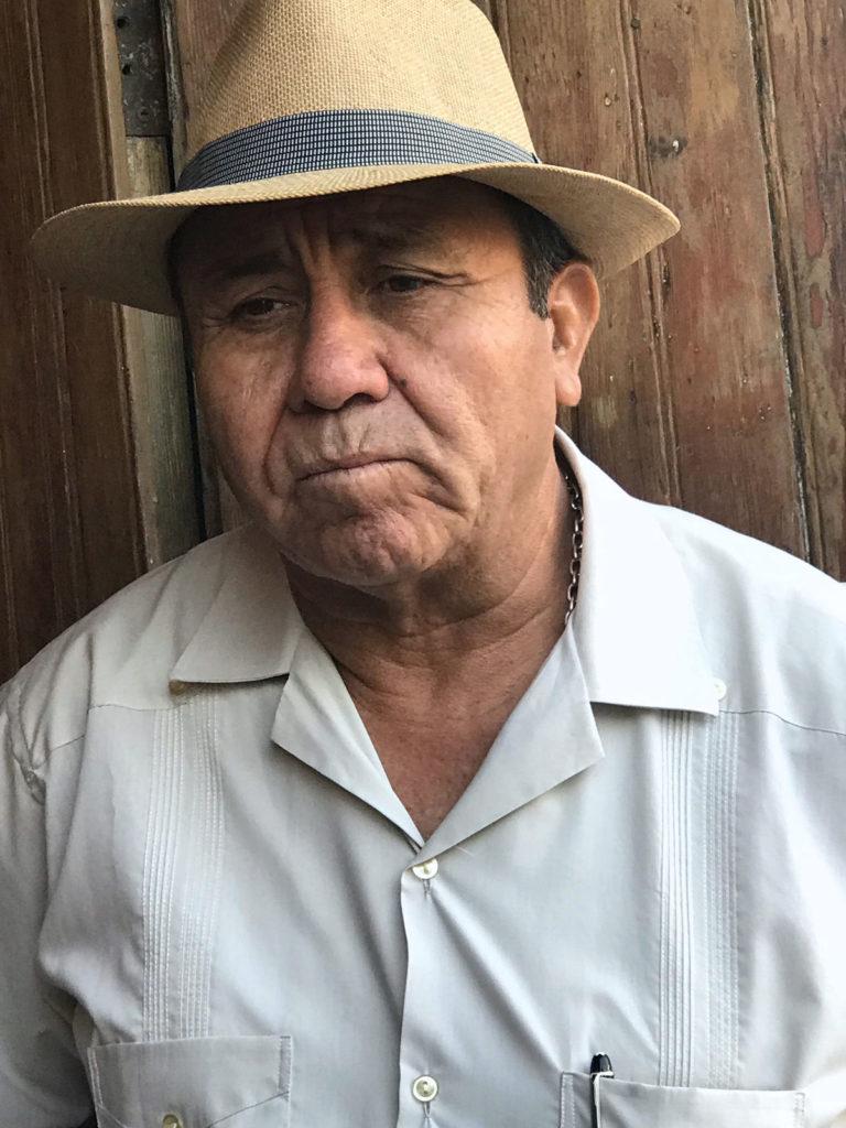 Closeup of a man in straw fedora - Peru