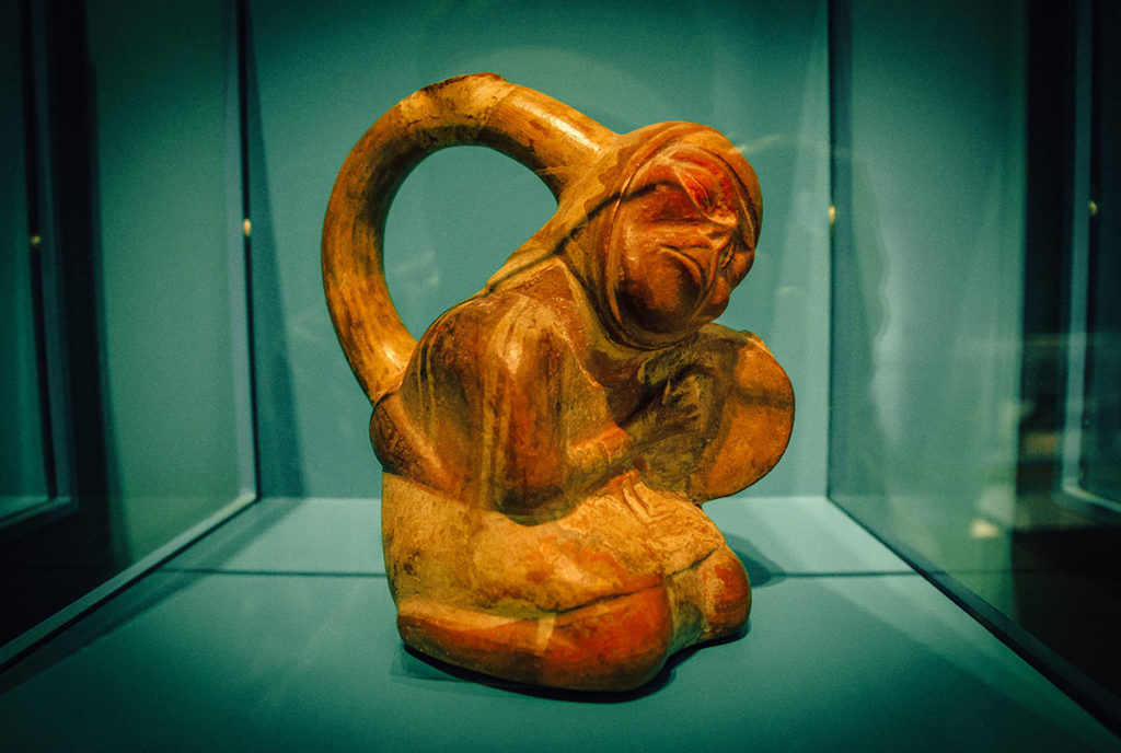 Ceramic bottle shaped like a man playing drum - Peru