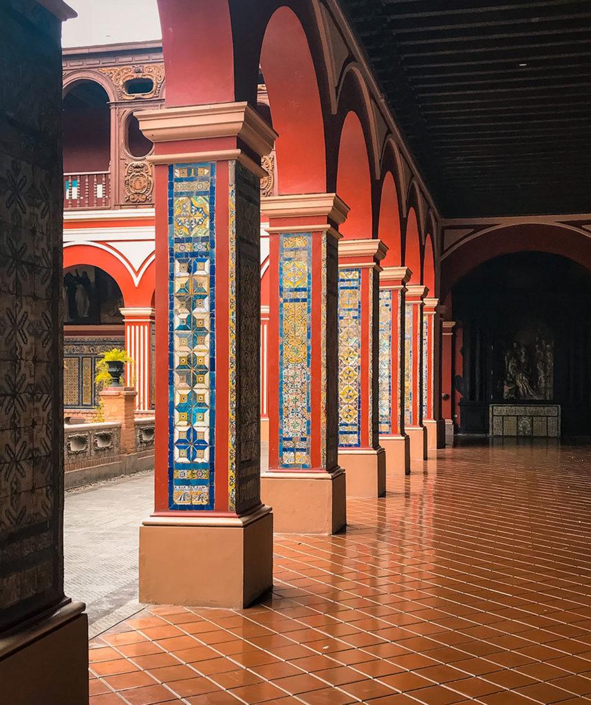 Adorned columns of the Domingo Courtyard - Peru