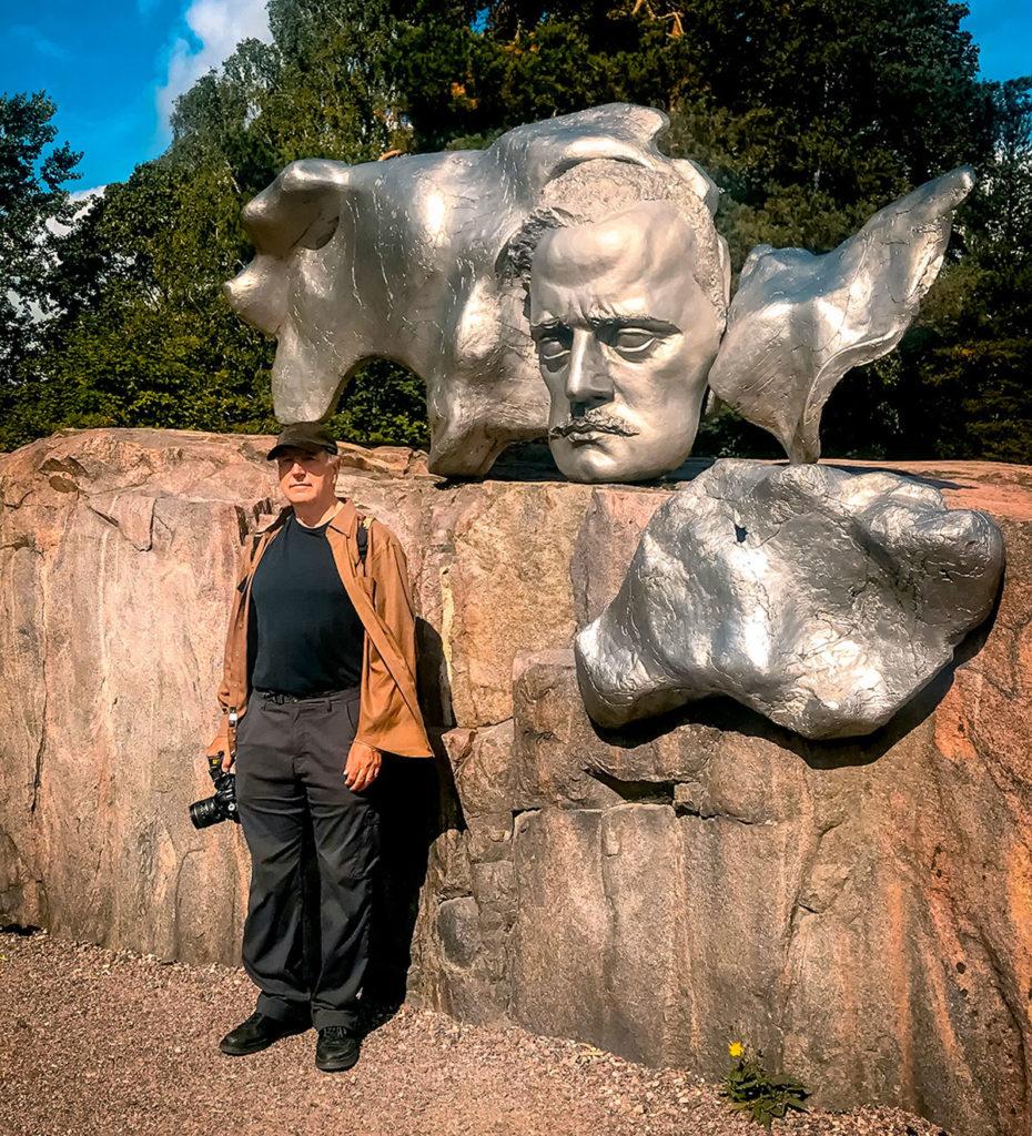 Ed in front of Jean Sibelius face sculpture - Sibelius Park