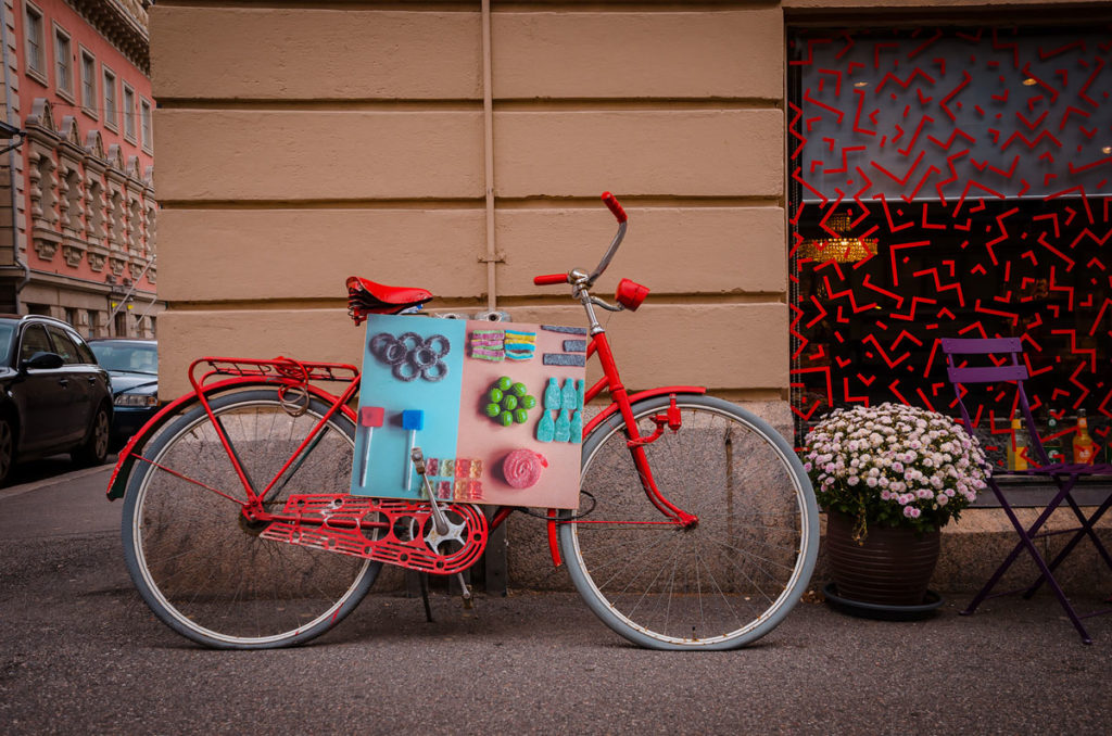 Parked red bicycle with advertising card  - Helsinki