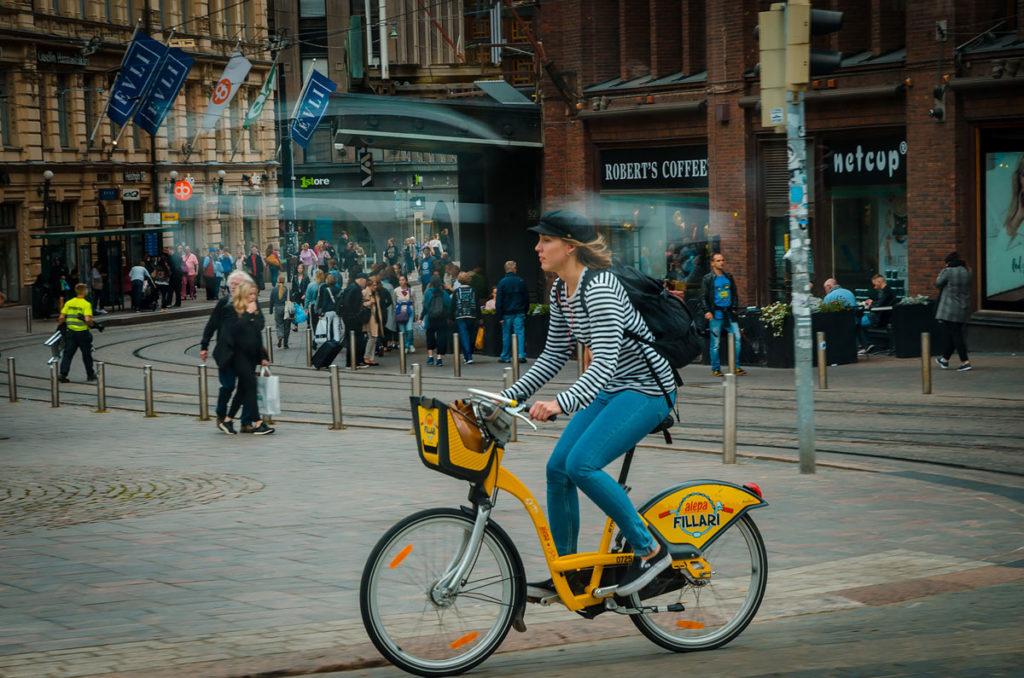 Woman riding a yellow bike - Helsinki