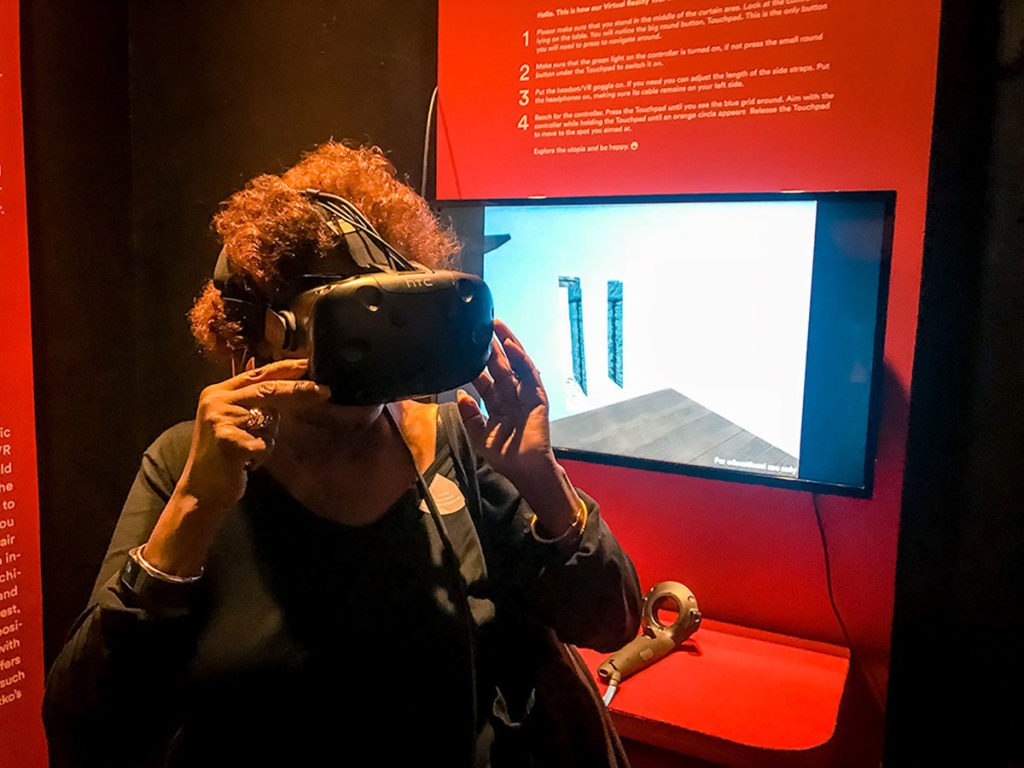 Khadija trying out a Virtual Reality device - Design Museum