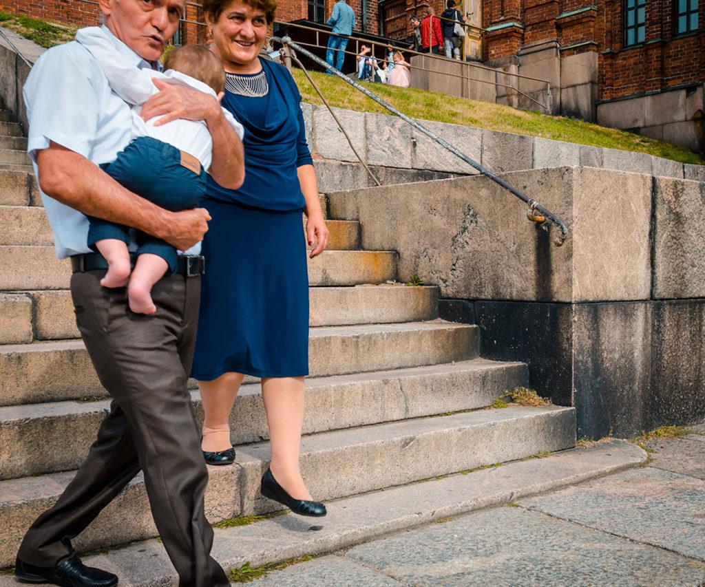 Grandparents baby grandson after baptism - Helsinki Cathedral