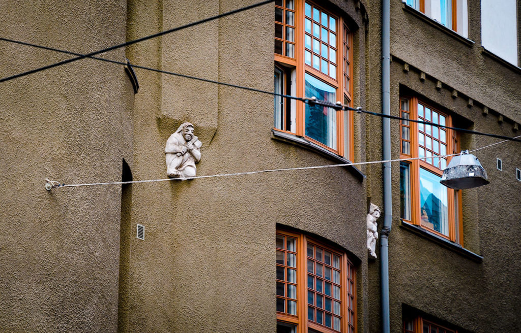 White troll sculpture on the wall - Helsinki
