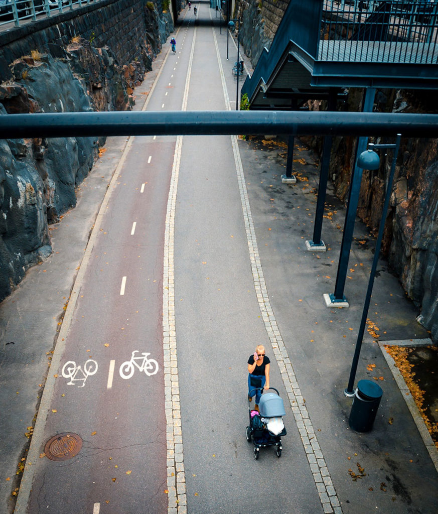Woman and baby along a bicycle path - Helsinki