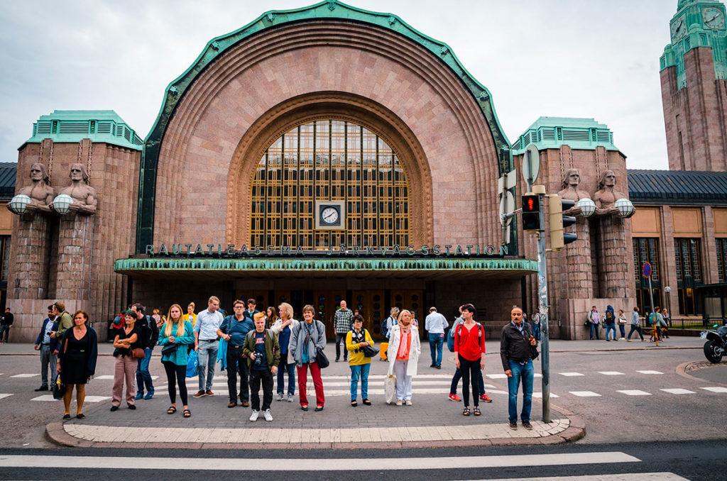 Pedestrians in front of the Art Nouveau Central Station - Helsinki