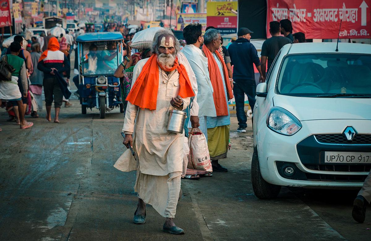 Sadhu on a crowded road - India