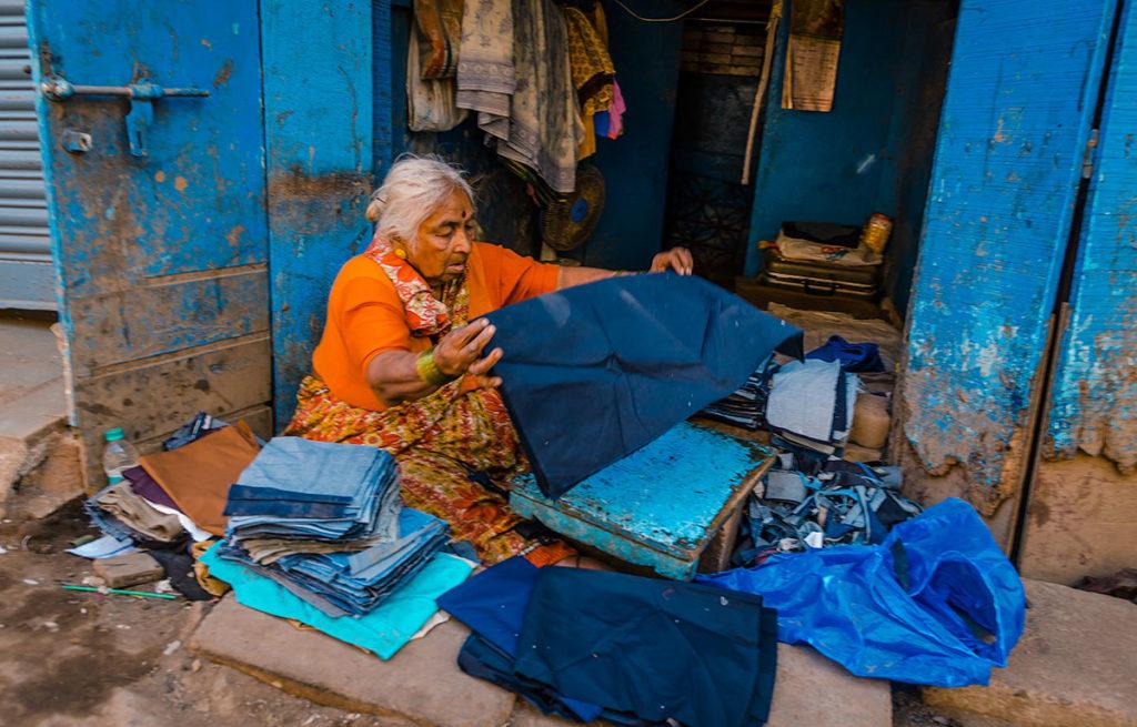 Elderly woman sorting fabrics - Dharavi
