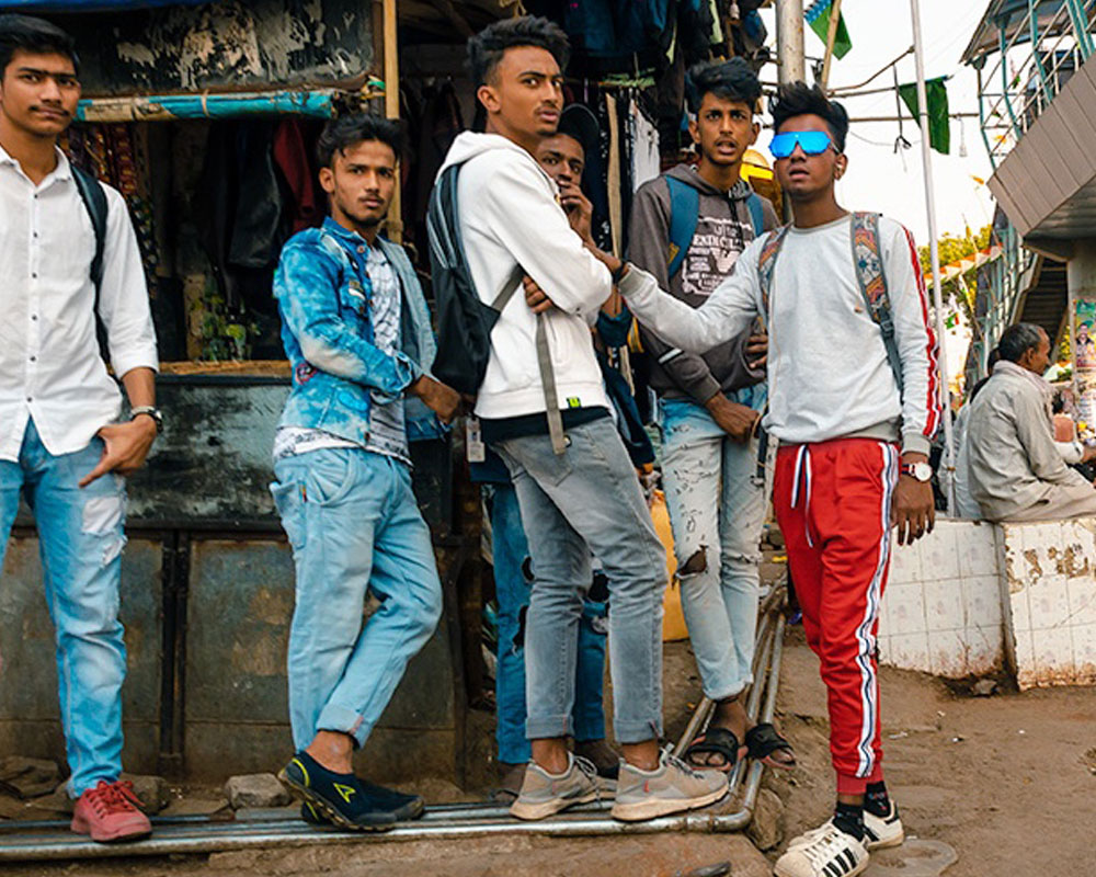 Group of young college students in backpacks - Dharavi