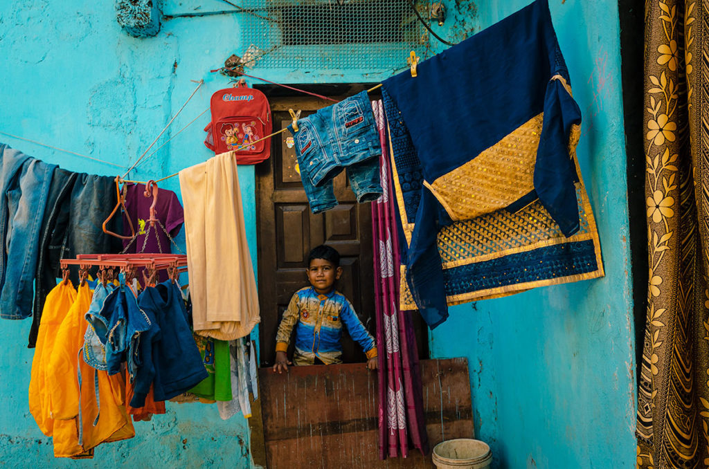 Young boy at the doorway - Dharavi