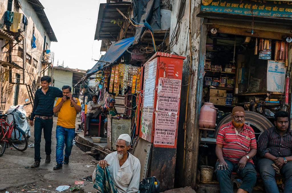 Men around a small shop - Dharavi