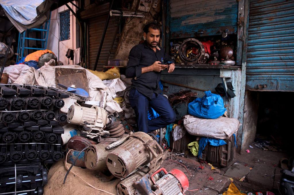 Man in his junk shop - Dharavi
