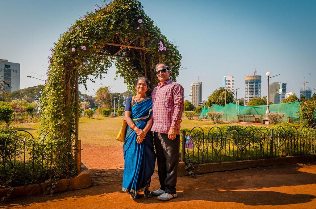 Elderly couple in front of the Hanging Garden - Mumbai