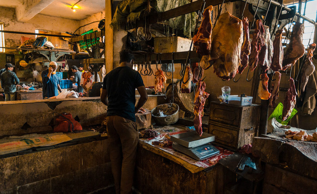 Butcher in a meat stall in Crawford Market - Mumbai