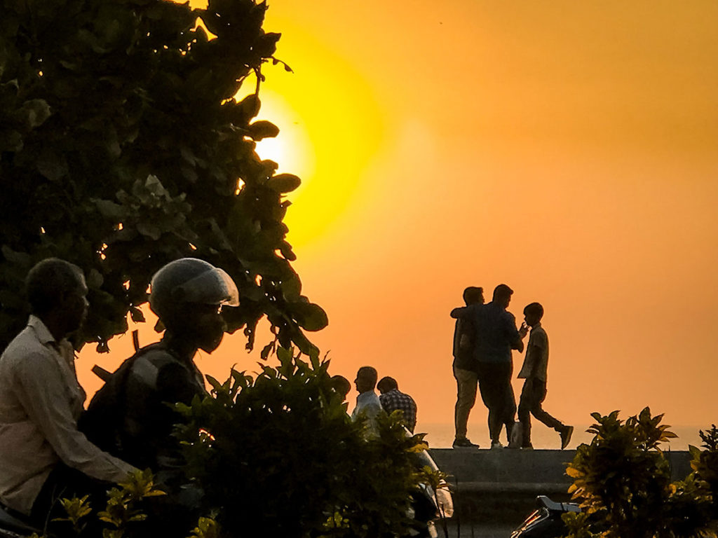People in front of a sunset view - Mumbai