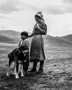 Mother and son living near Song-Kul Lake with their dog